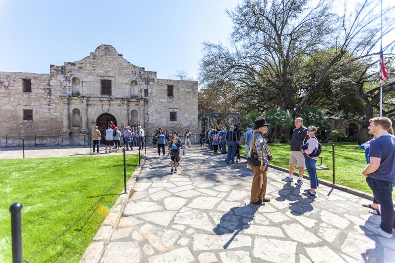 SAN ANTONIO, TEXAS - MARCH 2, 2018 - People get in line to visit the historical Alamo Mission, built in 1718 and site of the famou stock photos