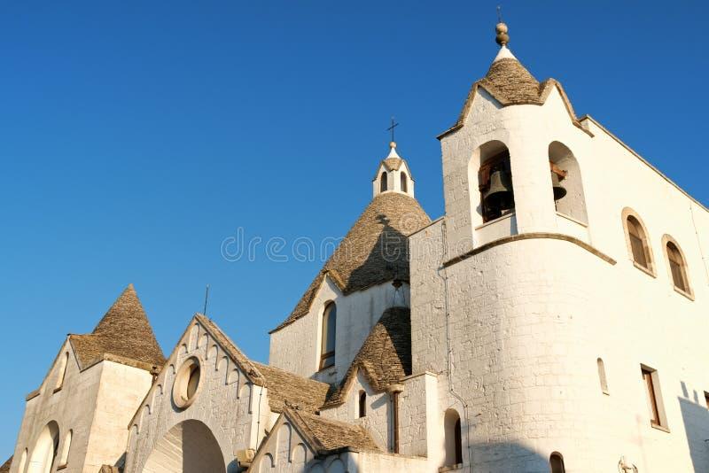 San Antonio trullo church in Alberobello, Italy stock images
