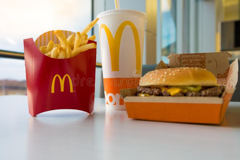 SAN ANTONIO, TX, USA - NOVEMBER 2, 2018 - McDonald`s Double Quarter Pounder burger with chesse, french fries potatoes and drink royalty free stock photos