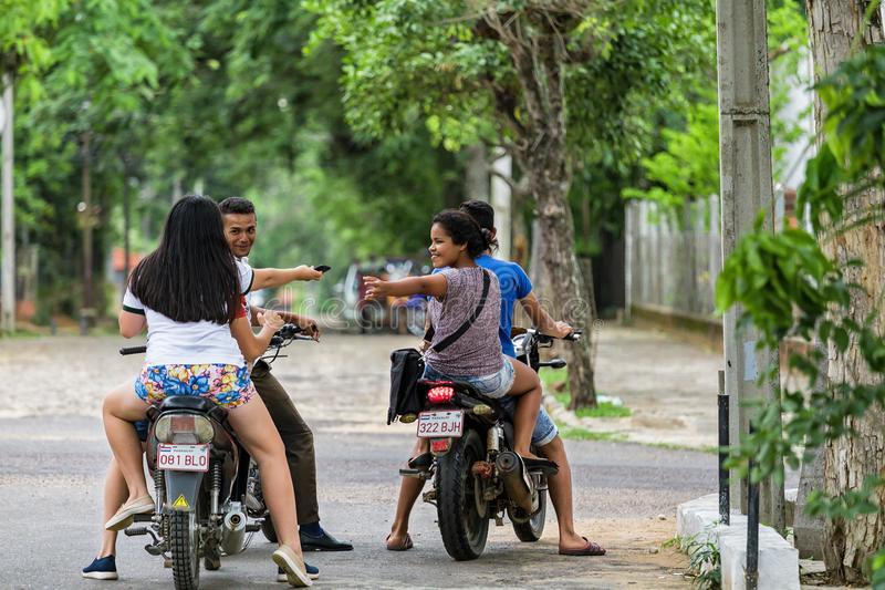 Four teenagers on motorcycles in San Bernardino-Paraguay stock images