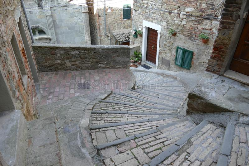 San Bernardino steps in Passignano on Trasimeno Lake. That lead to the clock tower through the ancient village stock photography