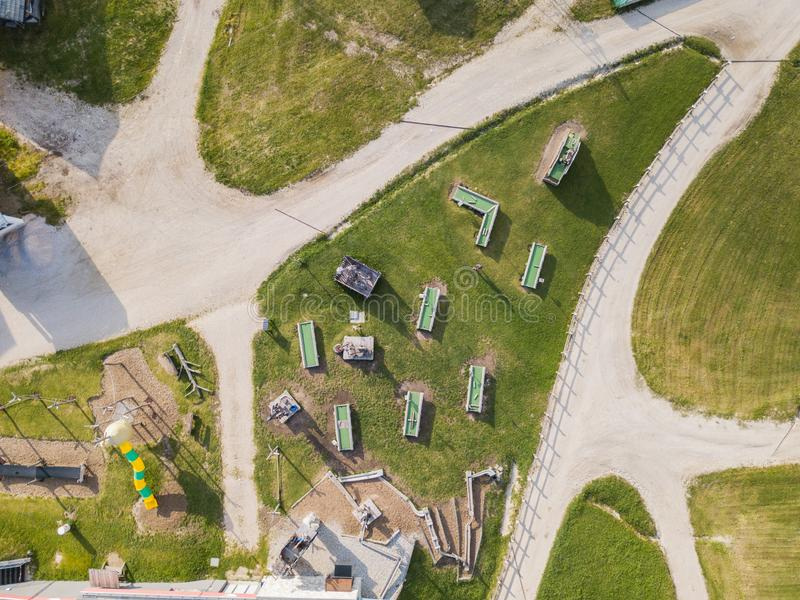 San Cassiano, Italy. Playground, outdoor gym, children`s mini golf, restaurants and water play at the arrival of the cableway. Piz Sorega. Summer time stock image