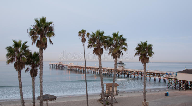 San Clemente Pier. In the early morning. Palm trees in the foreground stock photos