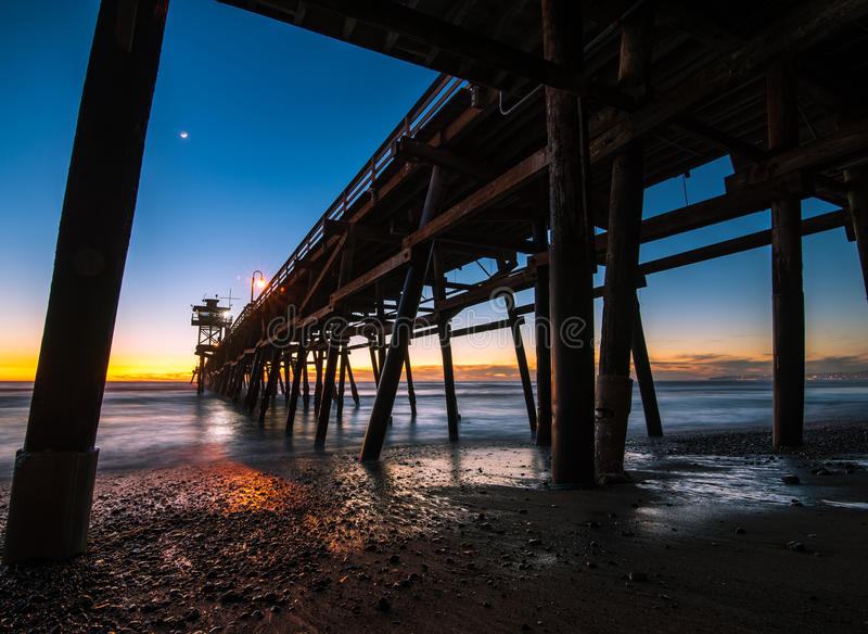 San Clemente Pier at blue hour. With moon and clouds on the horizon stock images