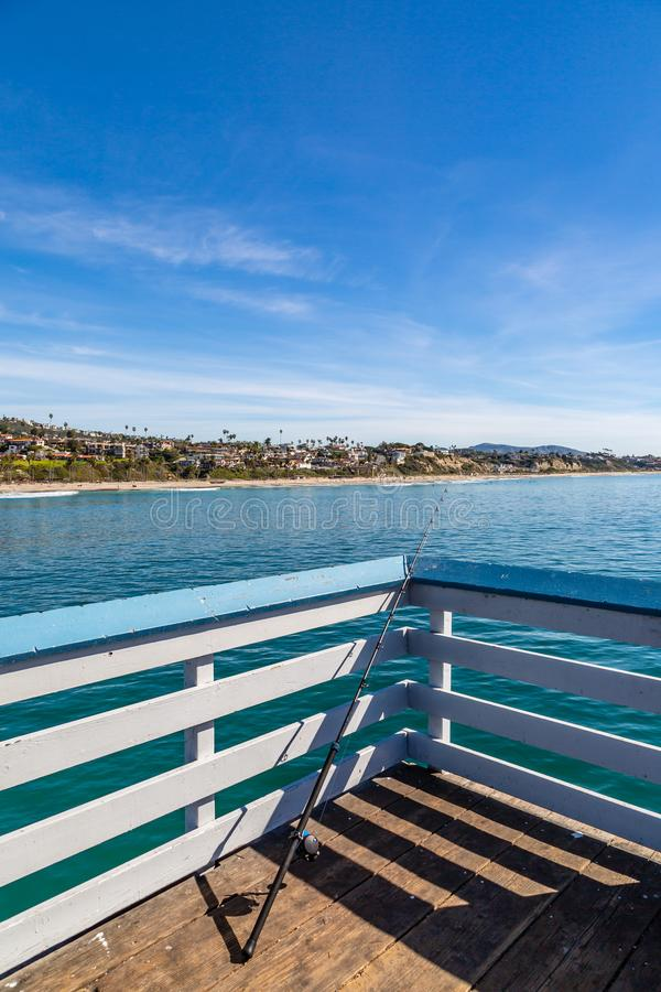 San Clemente Pier. A fishing rod on San Clemente Pier in California, on a sunny day stock photography