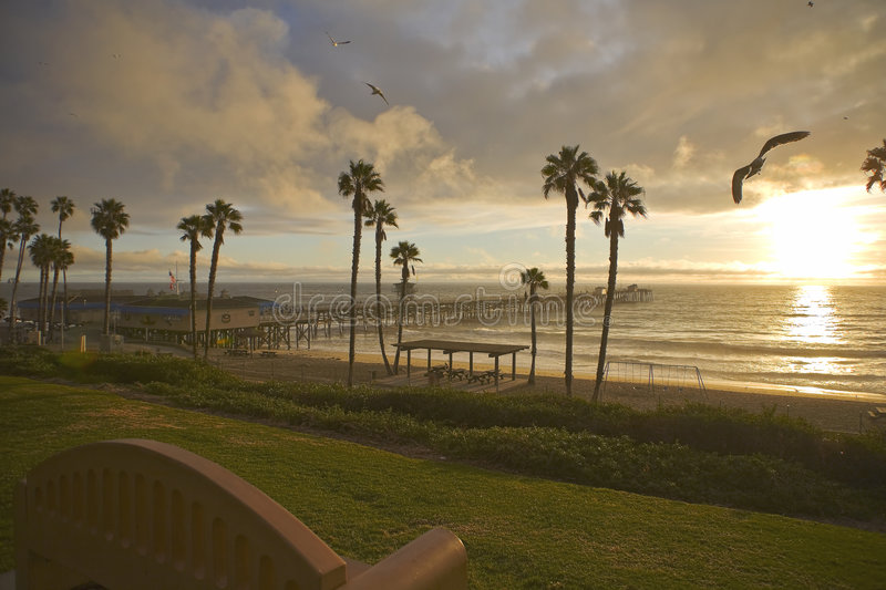 San Clemente Pier after a storm with Sea Gulls. San Clemente Sunset Pier after a storm with Sea gulls royalty free stock photo