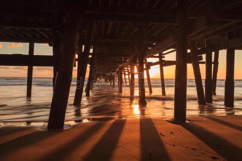 San Clemente pier at sunset in the fall. Under the San Clemente pier at sunset in the fall royalty free stock photography