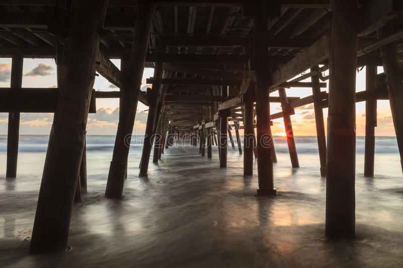 San Clemente pier at sunset in the fall. Under the San Clemente pier at sunset in the fall royalty free stock images