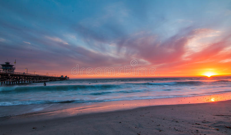 San Clemente Pier at sunset. Wide angle shot of san clemente pier and a vibrant sky stock photos
