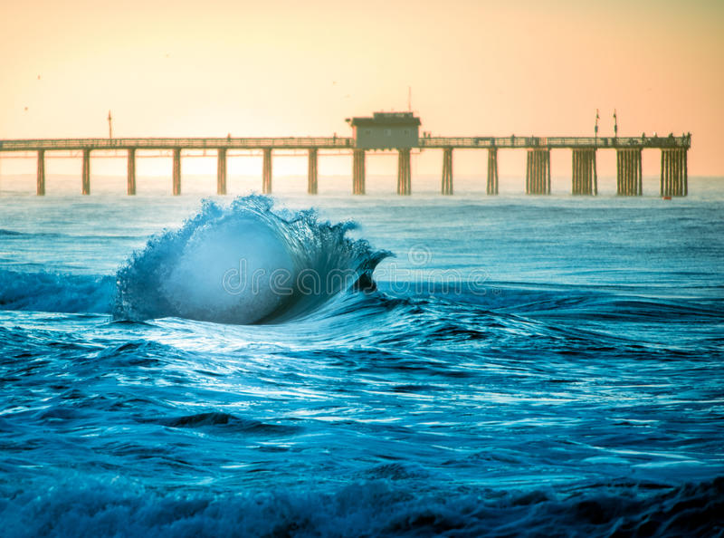 San Clemente Shore Break Flair. An exploding wave breaking on the shore in San Clemente, California royalty free stock image