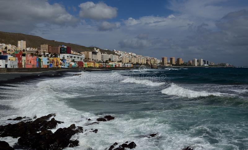 San Cristobal beach and city, Gran Canaria. Coast of Las Palmas with rough sea, view from the beach of San Cristobal, Gran Canaria stock photo