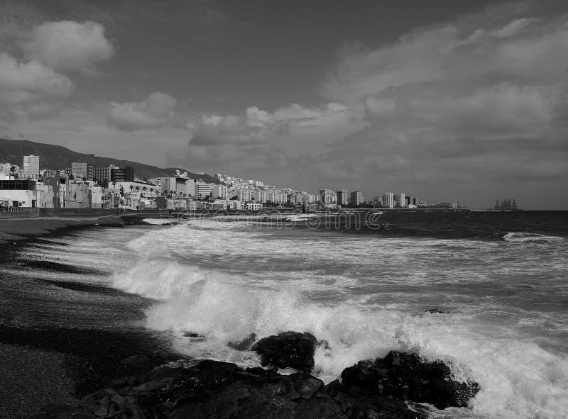 San Cristobal beach, Gran Canaria. San Cristobal beach with rough sea and city, Las Palmas de  Gran Canaria, black and white effect royalty free stock photos