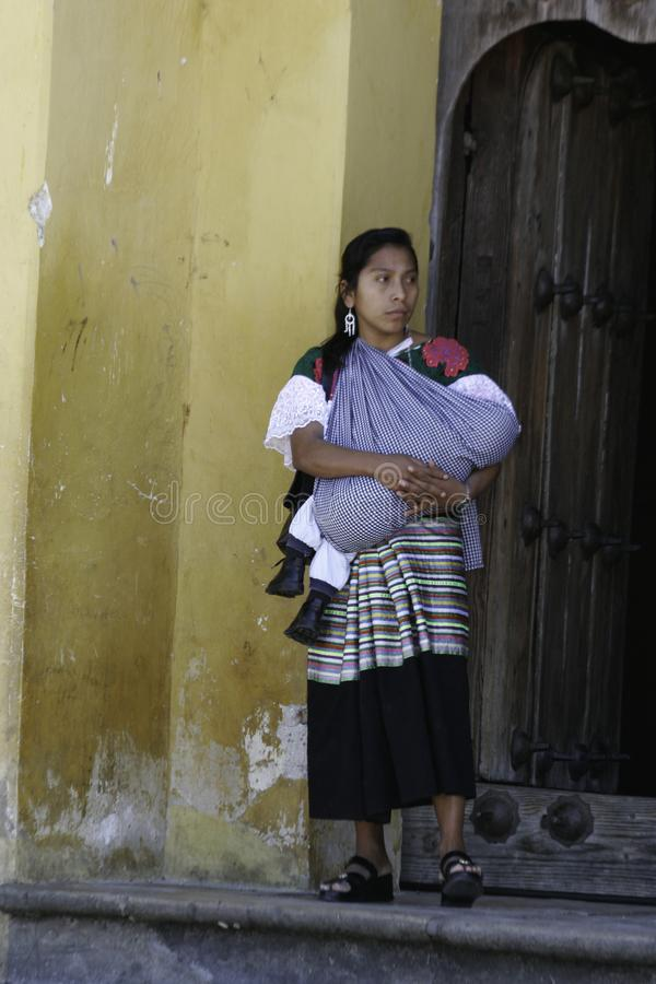 San Cristobal de Las Casas,Chiapas / Mexico - 12-21-2008 : native woman of Chiapas with her child in her arms. royalty free stock photos