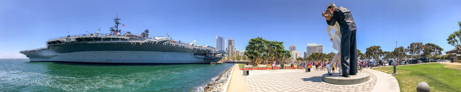 SAN DIEGO, CA - JULY 30, 2017: Tourists visit USS Midway near Em. Bracing Peace Statue. San Diego attracts 20 million tourists annually stock photos