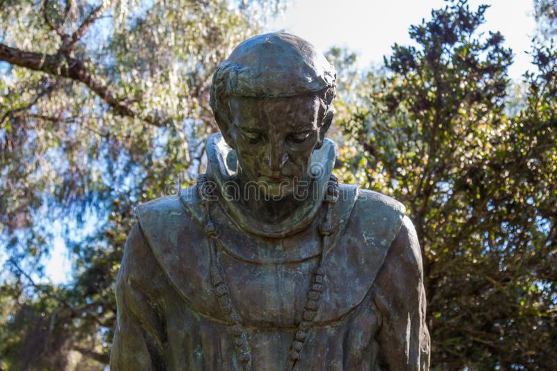 Statue of Father Junipero Serra. SAN DIEGO, CALIFORNIA - AUGUST 13, 2016:  A statue with the bowed head of Father Junipero Serra at the Serra Mission Museum, the royalty free stock photo