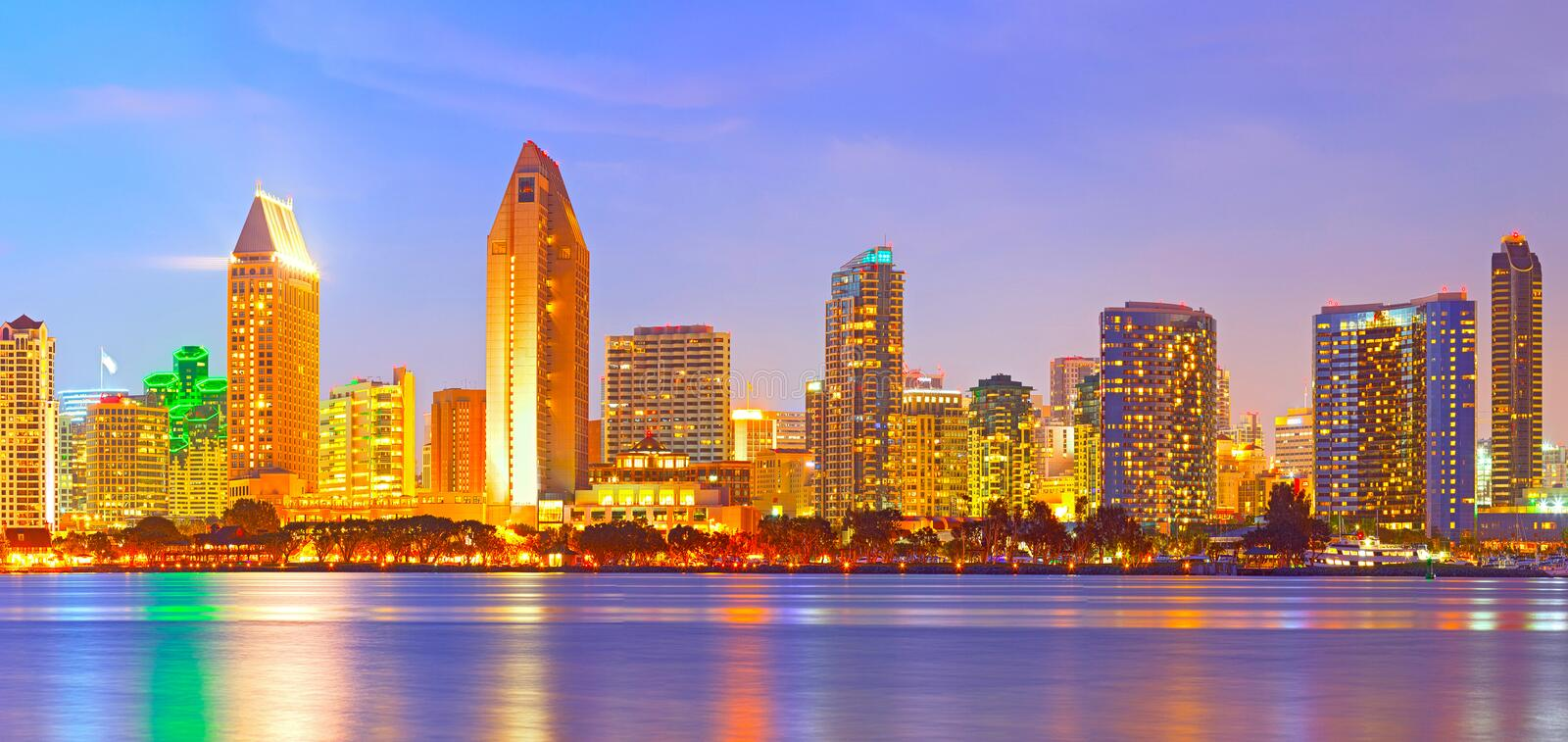 San Diego California. City skyline at sunset on a beautiful summer night with lighted skyscrapers and downtown buildings royalty free stock images