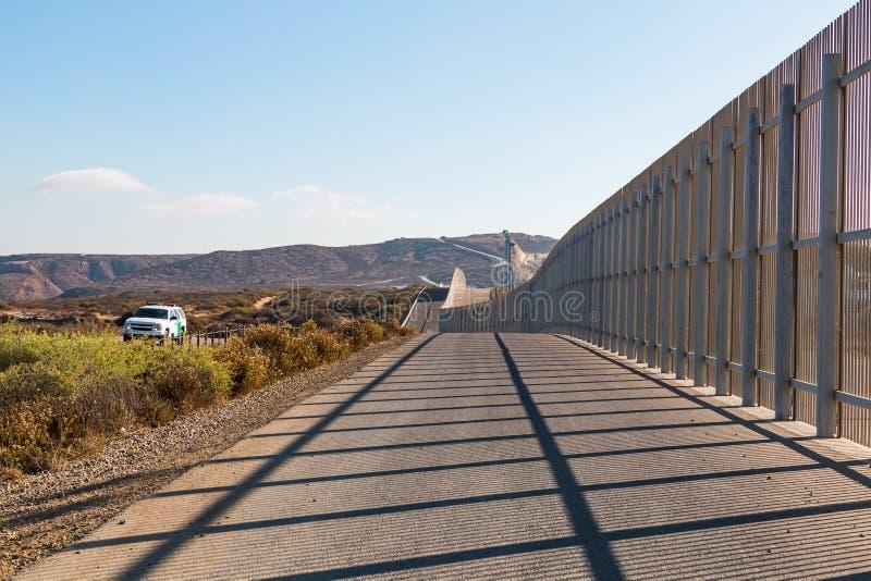 U.S. Border Patrol Vehicle at International Border Wall in San Diego. SAN DIEGO, CALIFORNIA - NOVEMBER 4, 2017: The international border wall separating San stock photography