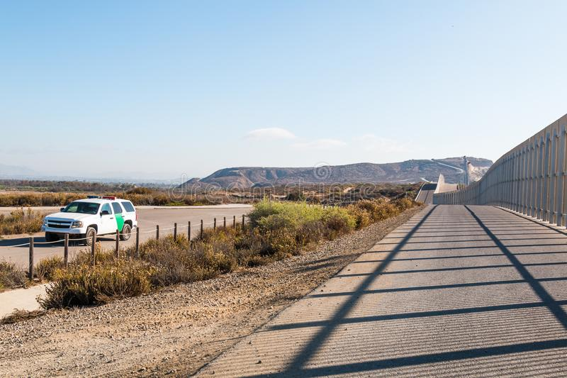 U.S. Border Patrol Vehicle Patrolling Near San Diego/Tijuana Border Wall. SAN DIEGO, CALIFORNIA - NOVEMBER 4, 2017: A U.S. Border Patrol vehicle patrols near the royalty free stock photo