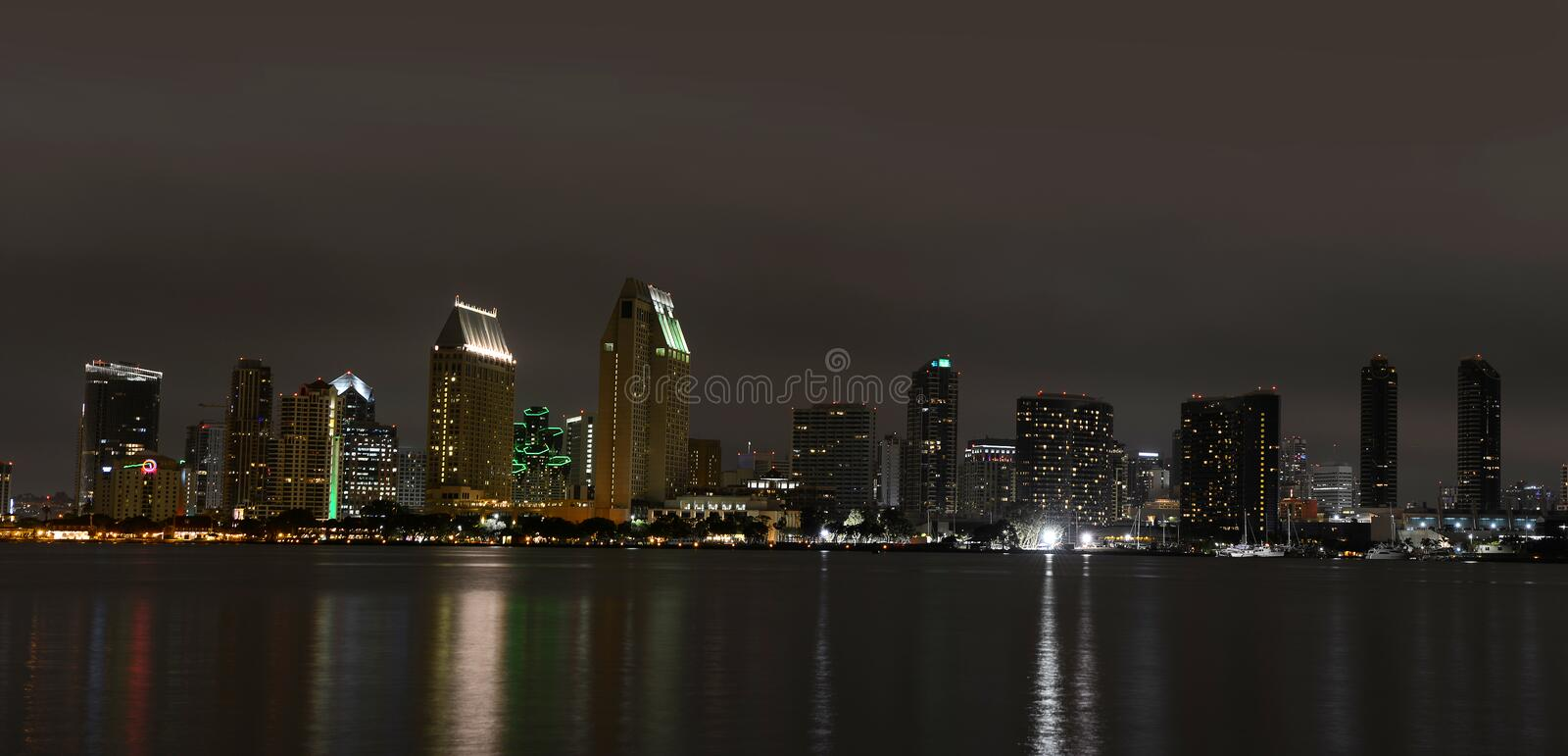 San Diego skyline at night. San Diego, California skylie panoramic view at nigh with reflections on the water royalty free stock photography