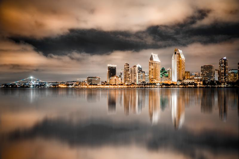San Diego California sunset Skyline colorful. Beautiful night skyline of San Diego California with bay of water and lit buildings stock photos