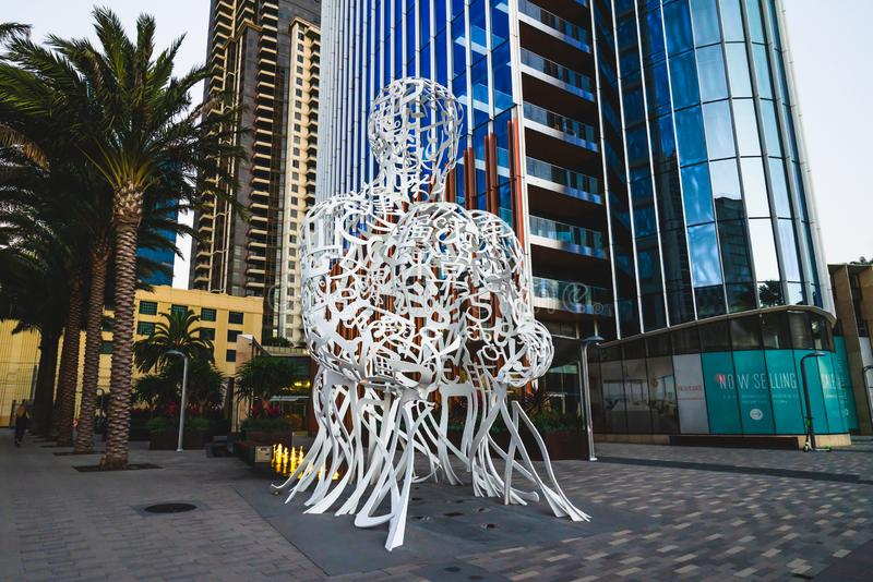 Pacific Gate residential tower and `Pacific Soul` sculpture by Jaume Plensa royalty free stock images