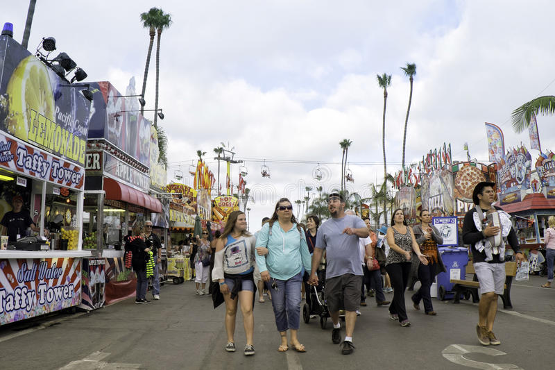San Diego County Fair, California. People walk down the main street of the San Diego County Fair, formerly the Del Mar Fair, with colorful food vendors lining stock photo