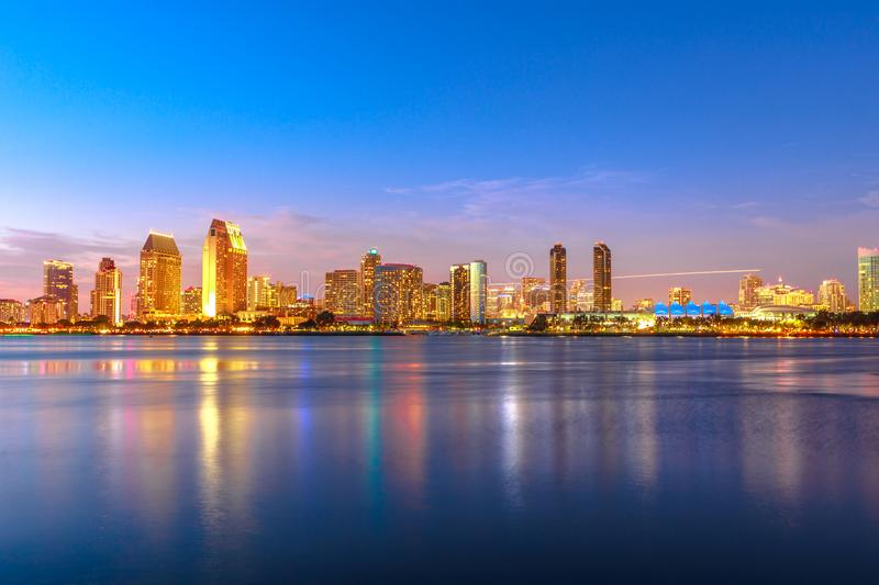 San Diego Downtown twilight. Panoramic landscape of San Diego skyline with illuminated skyscrapers reflecting in San Diego Bay at twilight. Districts of royalty free stock images