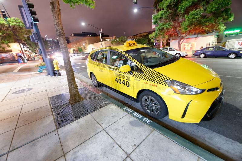 SAN DIEGO - JULY 30, 2017: Yellow cab awaits for customers. Th c. Ompany promotes the service with low rates and fast service royalty free stock photo