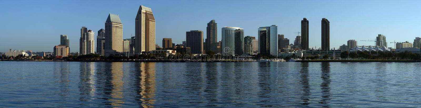 San Diego - Morning Skyline Panoramic. A panoramic view of downtown San Diego bathed in the golden glow of the early morning sunshine taken from the island of stock photography