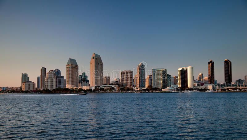 San Diego skyline on clear evening. Sun setting lights up the buildings on San Diego seafront royalty free stock images