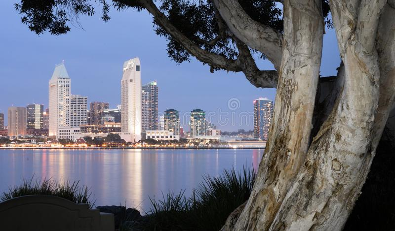 San Diego Skyline Downtown City Waterfront Coronado Island. Night falls on San Diego California as the bay reflects lights from buildings downtown royalty free stock photos