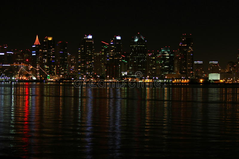 San Diego Skyline Night. The skyline of San Diego at night with reflection in the water royalty free stock image