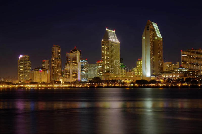 San Diego skyline from the water at night. HDR image of a partial skyline of San Diego, California viewed from the water after sunset stock photo