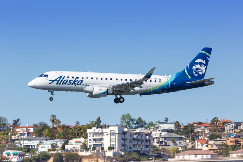 Alaska Airlines Skywest Embraer ERJ 175 airplane San Diego airport. San Diego, United States – April 13, 2019: Alaska Airlines Skywest Embraer ERJ 175 royalty free stock images