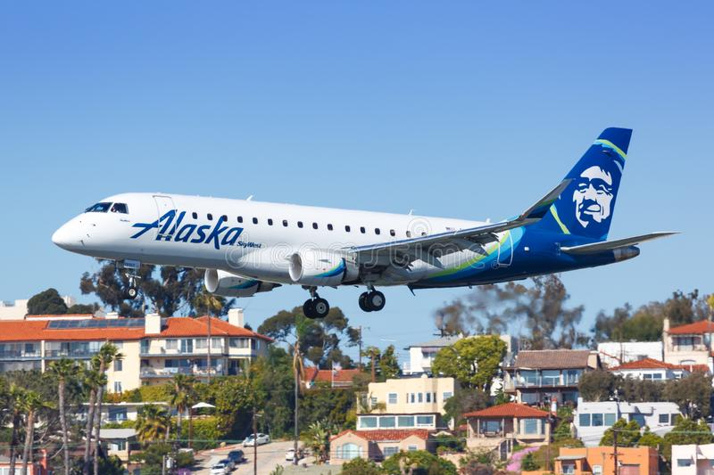 Alaska Airlines Skywest Embraer ERJ 175 airplane San Diego airport. San Diego, United States – April 13, 2019: Alaska Airlines Skywest Embraer ERJ 175 stock photo