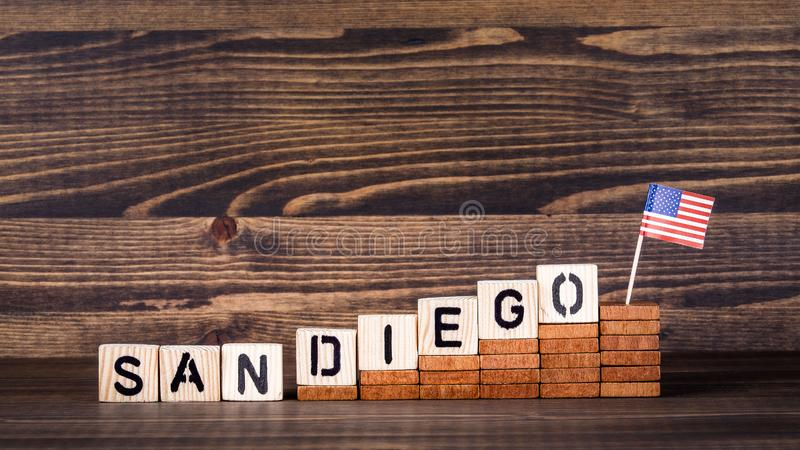 San Diego United States. Politics, economic and immigration concept. Wooden letters and flag on the office desk stock images
