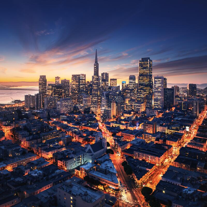 San Francisco aerial view from sea side. Port of San Francisco in the front. City downtown and skyscrapers at sunrise royalty free stock photography
