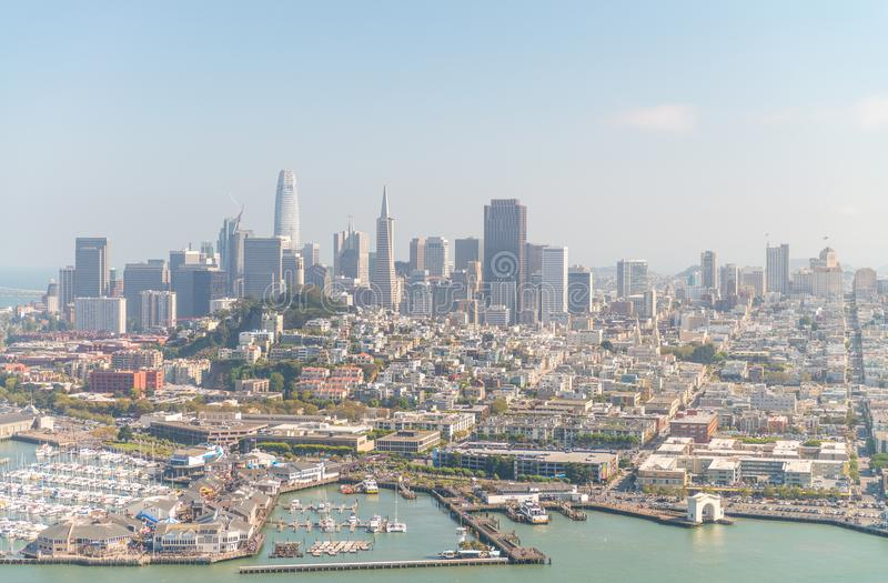 SAN FRANCISCO - AUGUST 2017: Aerial view of San Francisco skyline and Pier 39 on a beautiful sunny summer day. The city attracts stock photo