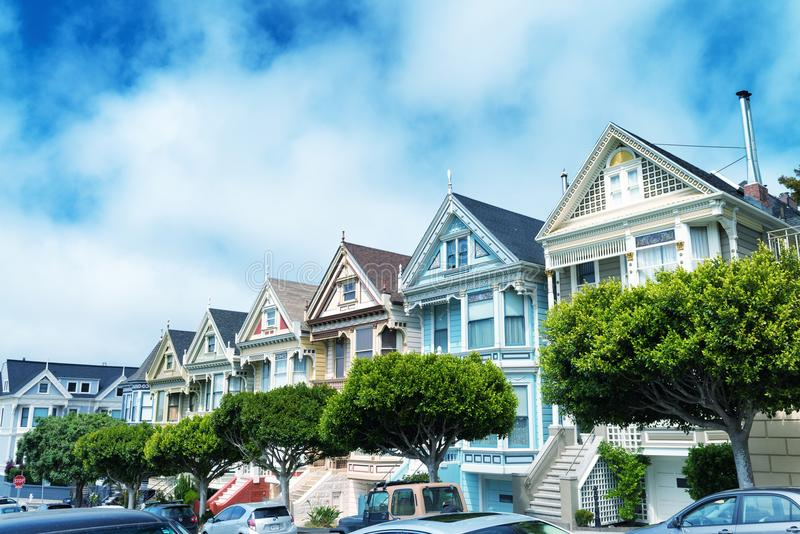 SAN FRANCISCO - AUGUST 2017: Painted Ladies are a row of colorful Victorian houses located near scenic Alamo Square - San Francis royalty free stock photo