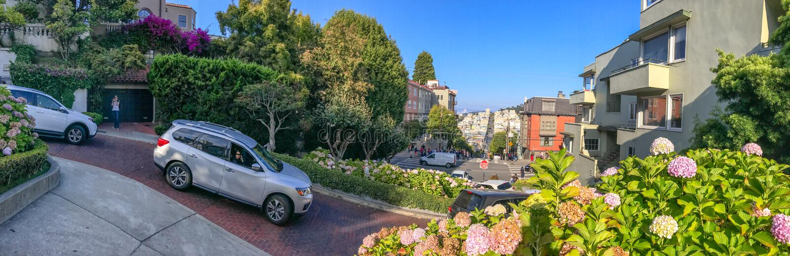 SAN FRANCISCO - AUGUST 7, 2017: Tourists and cars on Russian Hill. The city attracts 25 million people annually.  stock photography
