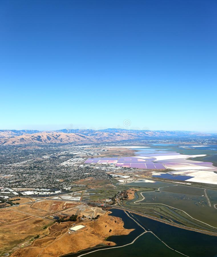 San Francisco Bay Area: Aerial view of Salt evaporation ponds and wetland marshes royalty free stock images