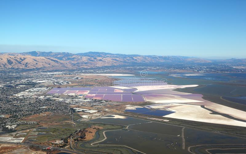 San Francisco Bay Area: Aerial view of Salt evaporation ponds and wetland marshes royalty free stock image