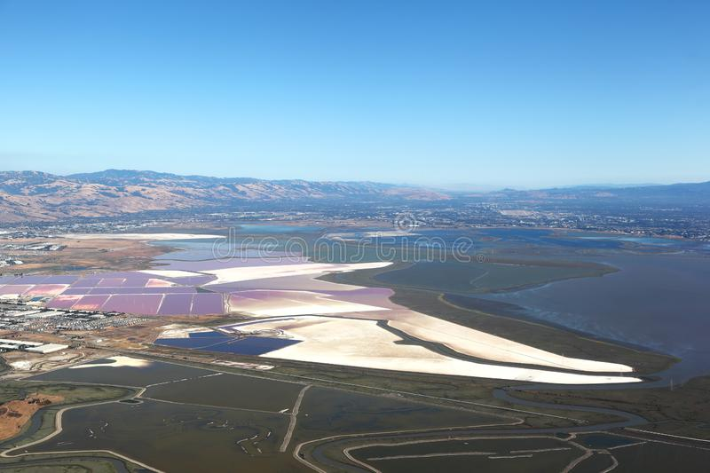 San Francisco Bay Area: Aerial view of Salt evaporation ponds and wetland marshes stock photos