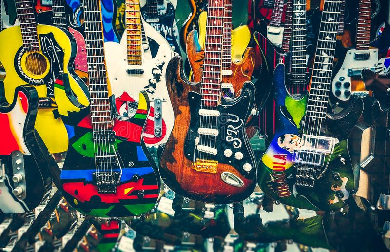 Many mini electric guitars small toy models background royalty free stock image