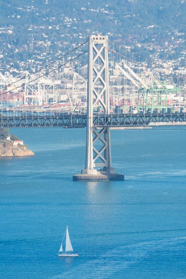 San Francisco bay bridge pillar. Detailed view over the San Francisco Oakland Bay Bridge pillar and skyline. Photo taken from the Coit tower royalty free stock image