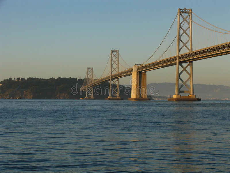 San Francisco Bay Bridge at Sunset. View of the western span of the San Francisco Bay Bridge at sunset stock photography