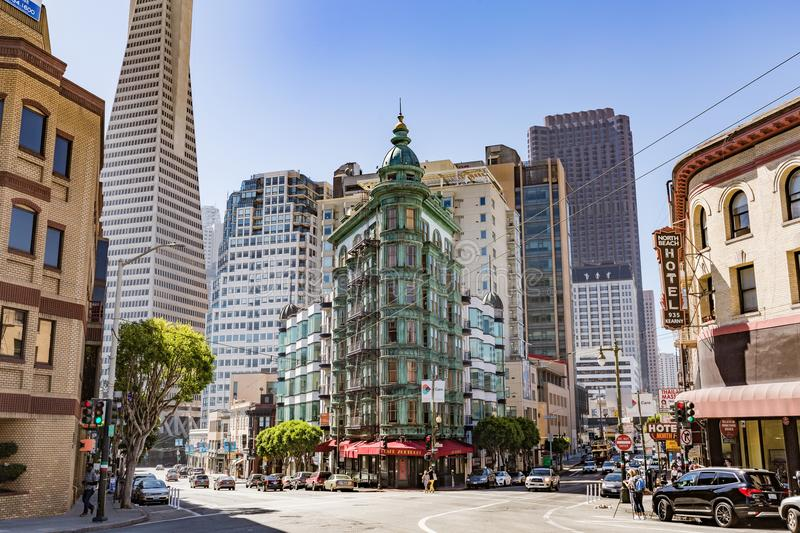 San Francisco, CA - July 16, 2017: Columbus Tower. The copper-green Flatiron style structure is a mixed-used building that was co royalty free stock image