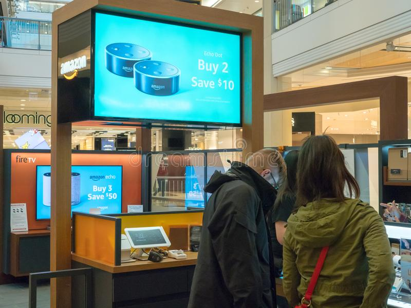 Shoppers browse an Amazon pop up store royalty free stock photos