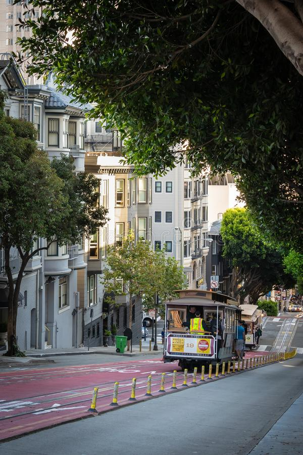 Tourists and locals on Cable Car/Trolley going down hill stock photo