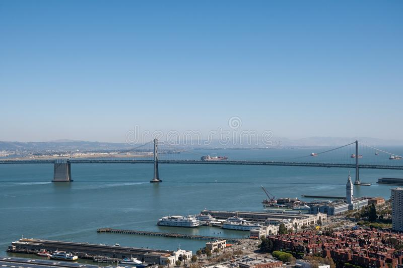 SAN FRANCISCO, CALIFORNIA - SEPTEMBER 9, 2015 - View of the Oakland Bay Bridge and the Ferry Building Marketplace from Coit Tower royalty free stock photos